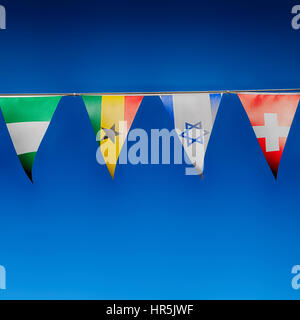 blur in south africa      decorative  waving flags from all over the world and sky - Stock Photo