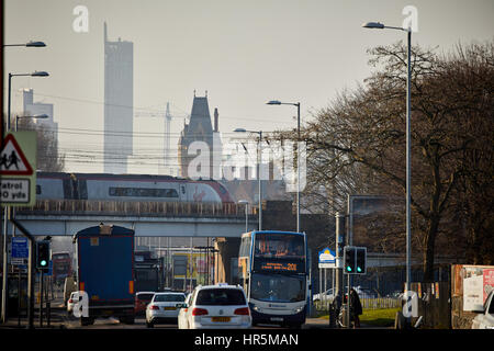 Hyde Road in Gorton a Virgin Class 390 Pendolino high speed EMU express train from London approaches Piccadilly - Stock Photo