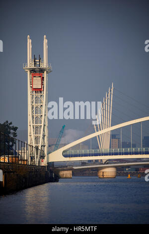 MediacityUK The Salford Quays lift bridge or Salford Quays Millennium footbridge over Manchester Ship Canal at Salford - Stock Photo