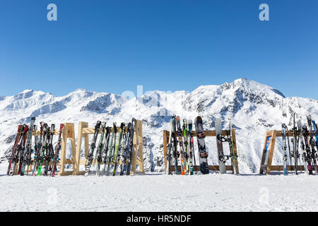 Skis and snowboards on racks outside a cafe on the slopes at Hochgurgl, Austria - Stock Photo