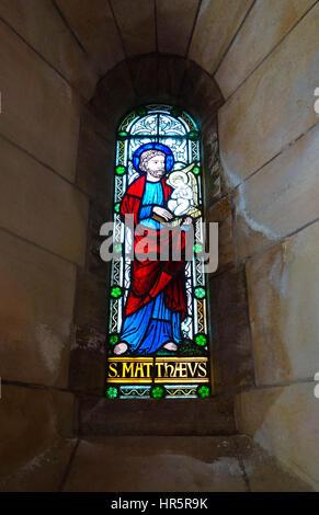 Stained glass depicting St. Matthæus (Matthew) the Evangelist Buckfast Abbey Devon England UK - Stock Photo