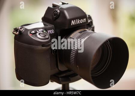 Nikon F100 35mm SLR film camera, with Nikon 50mm f1.4G lens attached. - Stock Photo