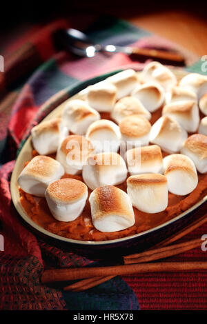 Marshmallow topped Sweet Potatoes - Stock Photo