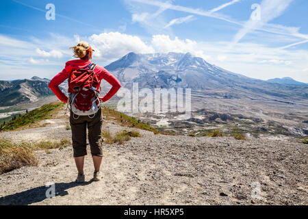 A woman hiking the Johnston Ridge  trail in Mount St Helens National Volcanic Monument, Washington, USA. - Stock Photo