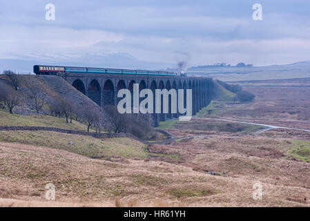 Locomotive, No. 60163 Tornado, a brand new Peppercorn A1 Pacific, travels across the Ribblehead Viaduct with snow - Stock Photo