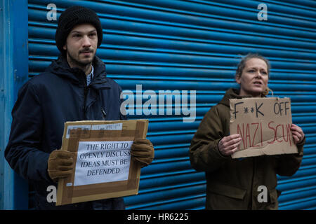 London, UK. 25th February, 2017. A woman contests a man standing outside the LD50 art gallery in Dalston with a - Stock Photo