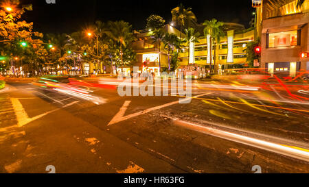 HONOLULU, OAHU, HAWAII, USA - AUGUST 21, 2016: cars crossing the Kalakaua Ave and Seaside Ave crossroad in motion - Stock Photo
