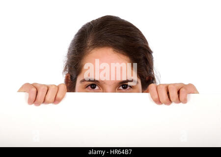 casual woman displaying a banner add isolated over a white background - Stock Photo