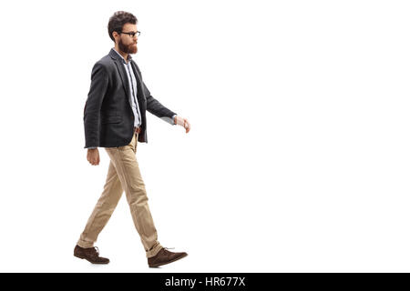Full length profile shot of a young bearded man walking isolated on white background - Stock Photo