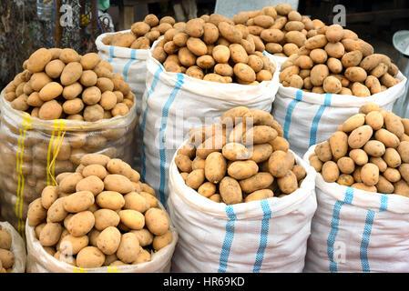 Sacks of potatoes for sale in the Local town market in Sheki, Azerbaijan - Stock Photo