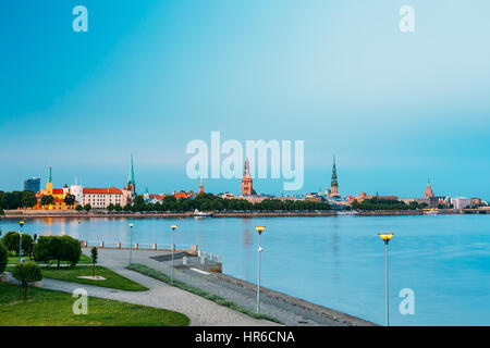 Scenic View To Promenad Of Daugava, In Riga, Latvia. Old Church Towers And Castle On Background. Evening View With - Stock Photo