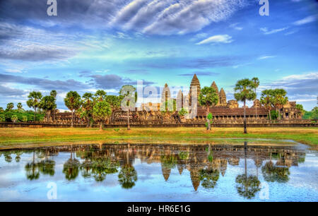 Angkor Wat seen across the lake, a UNESCO world heritage site in Cambodia - Stock Photo