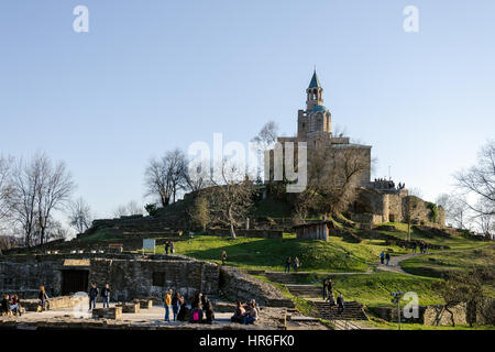 Patriarchal church at Tsarevets fortress and tourists, Veliko Tarnovo, Bulgaria - Stock Photo