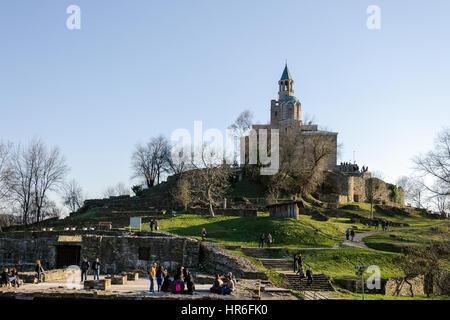 Patriarchal church at Tsarevets fortress and tourists, Veliko Tarnovo, Bulgaria - Stock Photo
