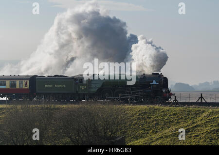 Puffing clouds of smoke, Locomotive, No. 60163 Tornado, a brand new Peppercorn A1 Pacific, travels across the Ribblehead - Stock Photo