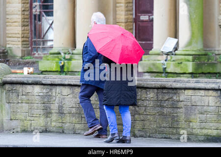 Southport, Merseyside, UK. 27th Feb, 2017. UK Weather. People venture into Southport town centre on a really wet - Stock Photo