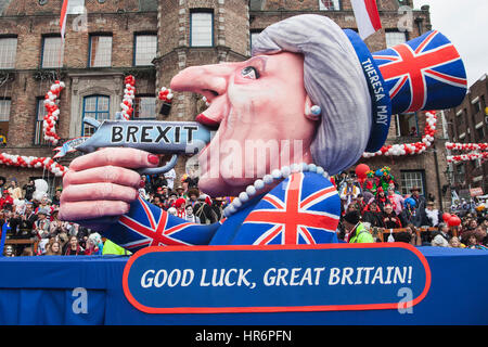 Düsseldorf, Germany. 27 February 2017. Float with a Theresa May figure shooting herself in the mouth over Brexit. - Stock Photo