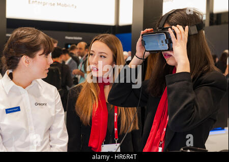 Barcelona, Spain. 27th Feb, 2017. A girl testing a Samsung Gear VR glasses during the Mobile World Congress wireless show in Barcelona. The annual Mobile World Congress hosts some of the world's largest communications companies, with many unveiling their latest phones and wearables gadgets. Credit: Charlie Perez/Alamy Live News