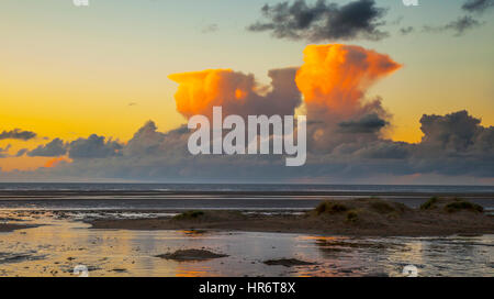 Southport, Merseyside, UK. 27th Feb, 2017. Weather. Sunset over Ainsdale Beach as towering Cumulus congestus clouds, - Stock Photo