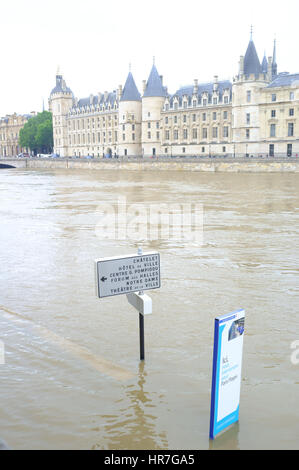 Submerged road sign with the overflowing River Seine, Paris - Stock Photo