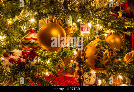 Christmas decorations on a tree. - Stock Photo