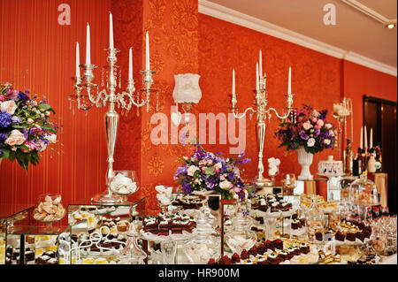 Different Types Of Cakes And Baking At Wedding Reception Table Stock