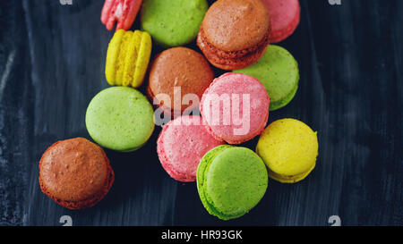 colorful macarons on black background - Stock Photo