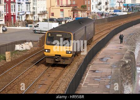 Passenger train passing through the seaside town of Dawlish in South Devon England UK - Stock Photo