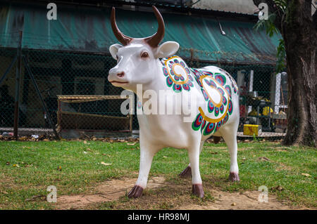 Sacred Hindu cow statue in Little India, Singapore - Stock Photo