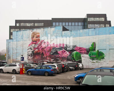 Telmo and Miel a Dutch duo of mural artists have painted this impressive toddler in a puddle on a concrete building - Stock Photo