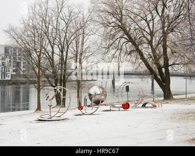 fitness equipment on the banks of Drammenselva in Drammen Norway on a winters day with decorative hoar frost - Stock Photo