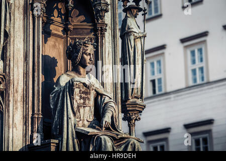 Personification of the Faculty of Law, decoration of the statue of Charles IV. Prague, Czech Republic. - Stock Photo