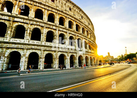 View of Colosseum at sunset in Rome, Italy. - Stock Photo