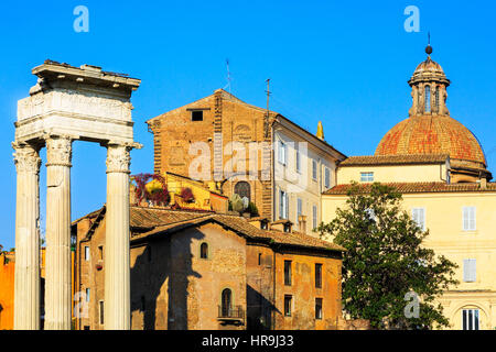 Building details with old Roman pillars on Via San Marco, Rome, Italy - Stock Photo