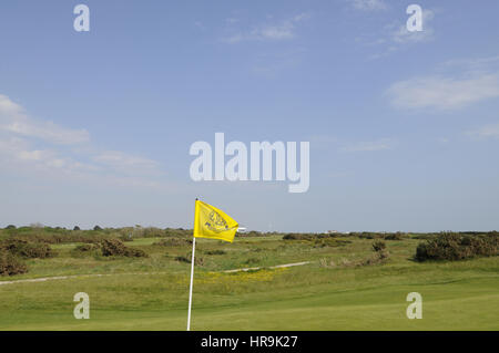 View over 4th Green with flag and The Clubhouse in far distance, Hayling Golf Club, Hayling, Hampshire, England - Stock Photo