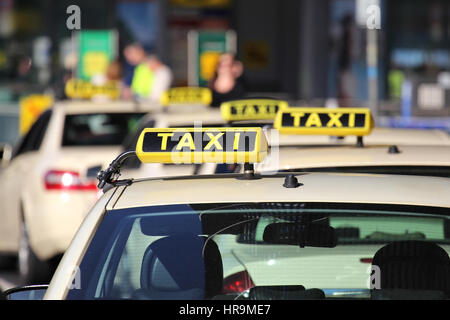German taxi cabs waiting for passengers - Stock Photo