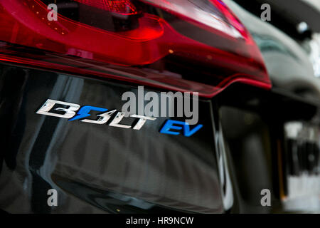 A logo badge on a 2017 Chevrolet 'Chevy' Bolt EV electric car. - Stock Photo