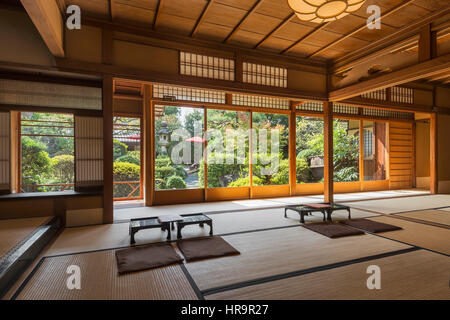 Interior of a tranditional Japanese tea and dessert house with Zen garden in Kyoto, Japan - Stock Photo