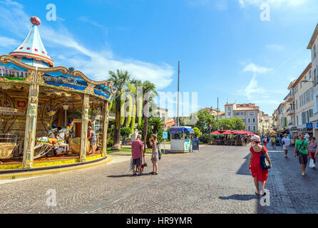 Place des Martyrs de la Résistance with tourists and carousel in Antibes, France. - Stock Photo