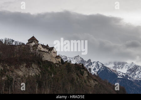 Vaduz Castle overlooking the city below it in Liechtenstein in winter - Stock Photo
