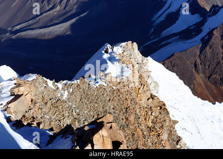 Climbers on the summit ridge og Huayna Potosi in the Bolivian Andes - Stock Photo