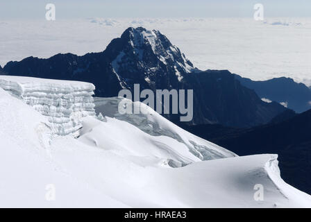 A view across the Andes from high on Huayna Potosi on the Bolivian Andes - Stock Photo