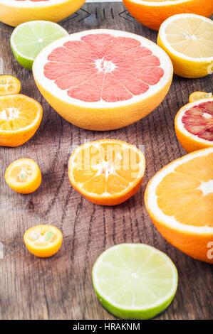 Colorful fresh citrus fruit on wooden background. Orange, tangerine, lime, blood orange, lemon, grapefruit. Fruit - Stock Photo