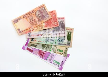 Indian Rupees - Indian currency notes of various denominations on a white background - Stock Photo