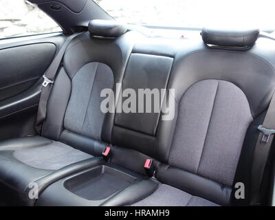 Leather seats - black anthracite - royal - soft leather - Dark luxury car Interior - steering wheel, shift lever - Stock Photo