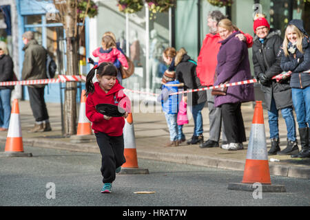 The Grove, Ilkley, West Yorkshire, UK. 28th Feb, 2017. Watched by members of the public, a young competitor (little - Stock Photo