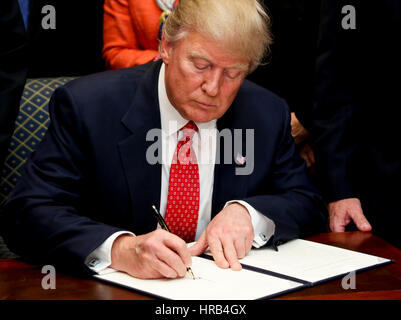 Washington, Us. 28th Feb, 2017. United States President Donald Trump signs an Executive Order, to roll back the - Stock Photo