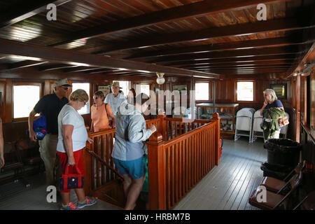 Day trip passengers debarking from the Century-old Motor Vessel Katahdin - Stock Photo