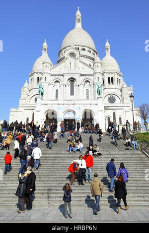 PARIS, FRANCE - March 4 ,2011: People in front of Sacre Coeur Basilica on Montmartre - Stock Photo