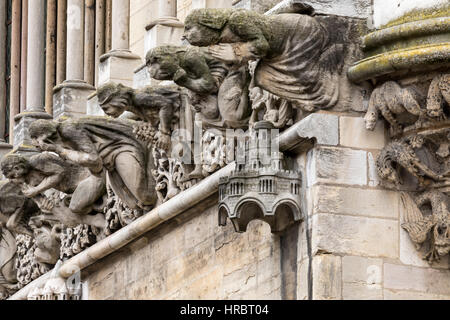 Fanciful gargoyles on the facade of Notre Dame Church, Dijon, Burgundy, France - Stock Photo